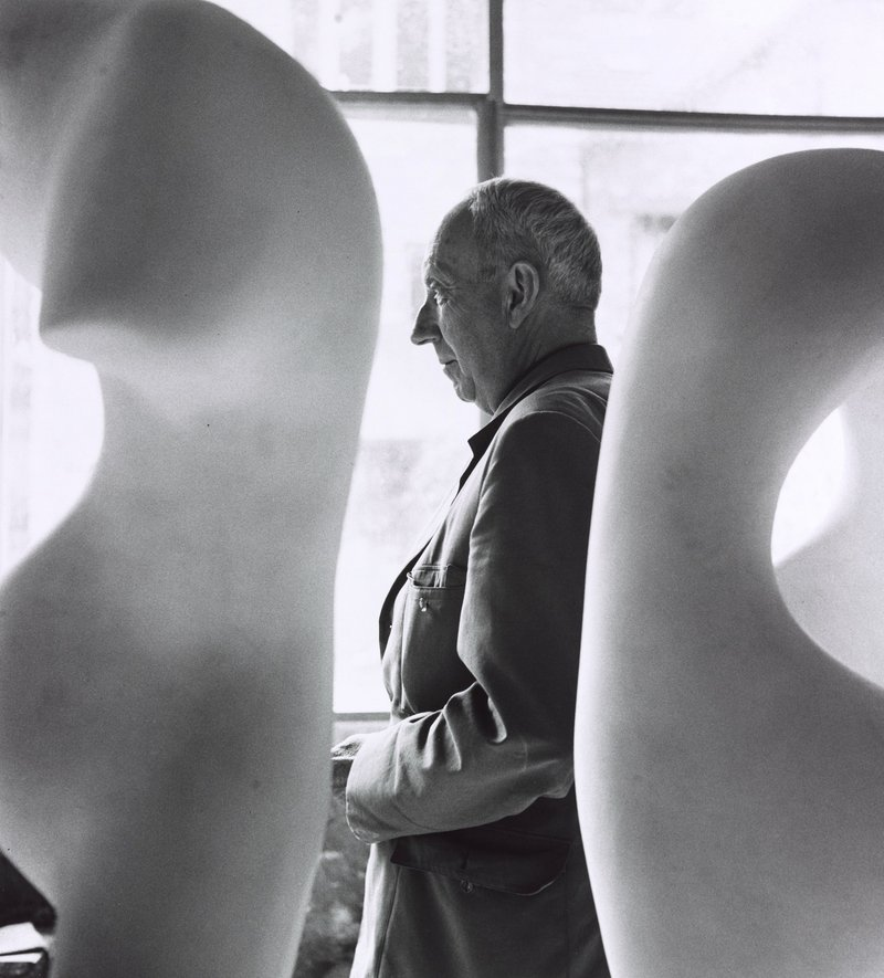 Jean Arp, middle, as photographed by Robert Doisneau, 1958, printed 1984, gelatin silver print.