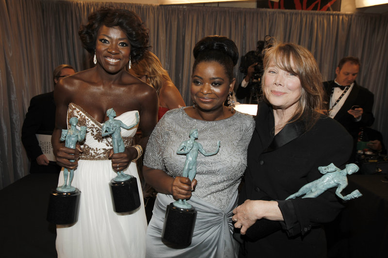 "Viola Davis, left, Octavia Spencer, center, and Sissy Spacek gather backstage after accepting the award for overall cast performance for ""The Help"" at the Screen Actors Guild Awards on Sunday. Davis also won as best actress."