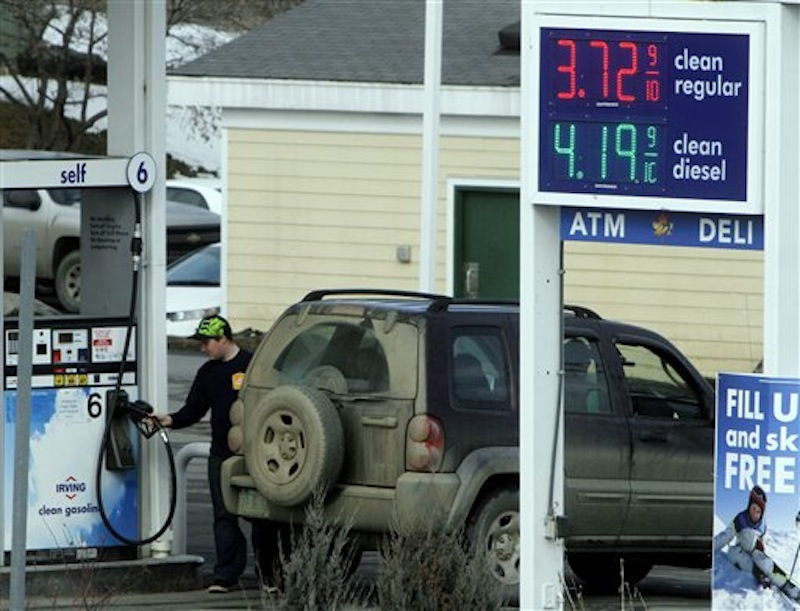 In this Feb. 16 photo, a customer fills up at an Irving Oil gas station, in Berlin, Vt. Gasoline prices have never been higher at this time of year. (AP Photo/Toby Talbot)
