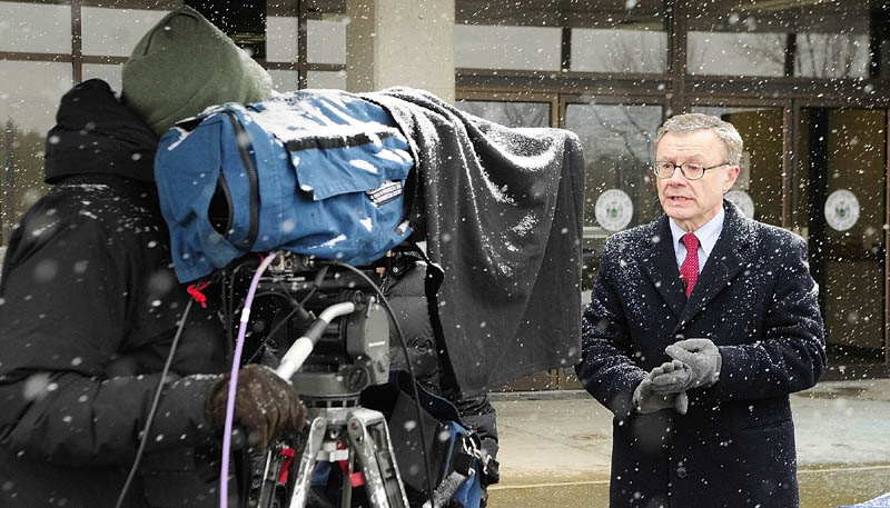 Maine State Police spokesman Steve McCausland stands in the snow outside the Department of Public Safety in Augusta as he is interviewed via satellite about the Ayla Reynolds case on a national news show on Tuesday afternoon.
