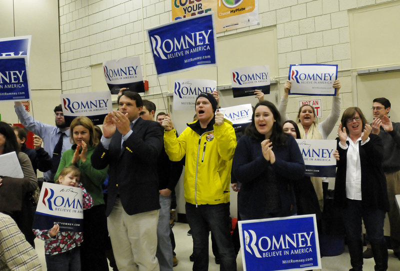 Supporters of Mitt Romney cheer Saturday as their candidate is introduced during the Portland Republican City Committee Caucus at Riverton Elementary School in Portland.