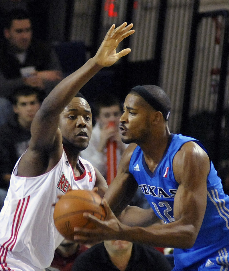 Craig Brackins defends against Sean Williams of the Texas Legends during the Red Claws' 114-107 loss Sunday at the Portland Expo.