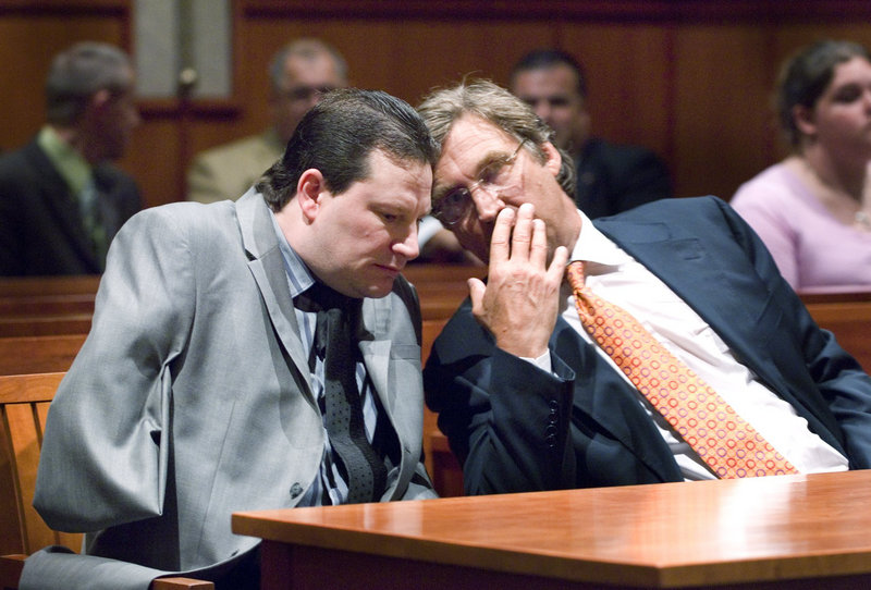 Douglas Tenczar, left, confers with his attorney, Thomas Hallett, during court proceedings in August 2009 in connection with a 2008 road rage incident. On Monday, Tenczar filed suit, alleging that the deputies who investigated the road rage incident used excessive force.