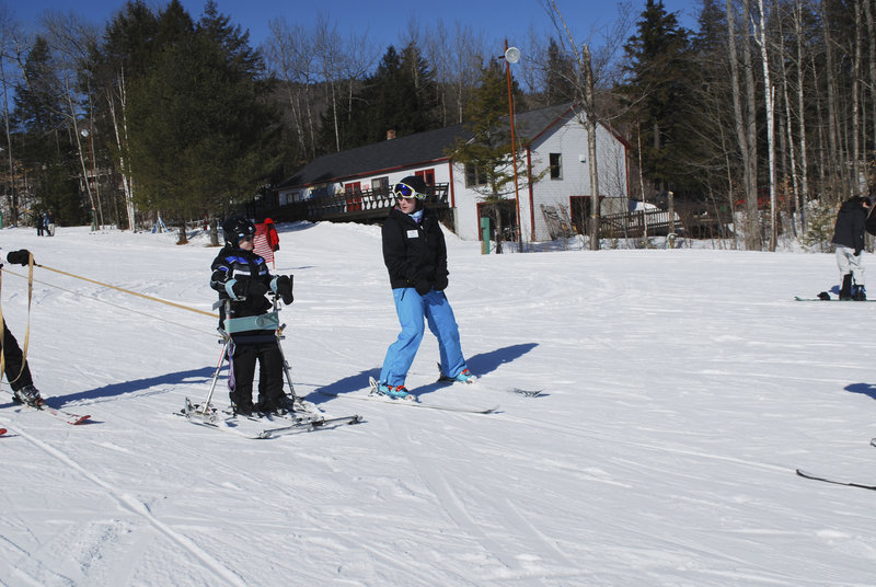 Max Thorman of Crescent Park Elementary School receives instruction from Margaret Adams, a Gould Academy senior and a ski coach in the Rugrats program.
