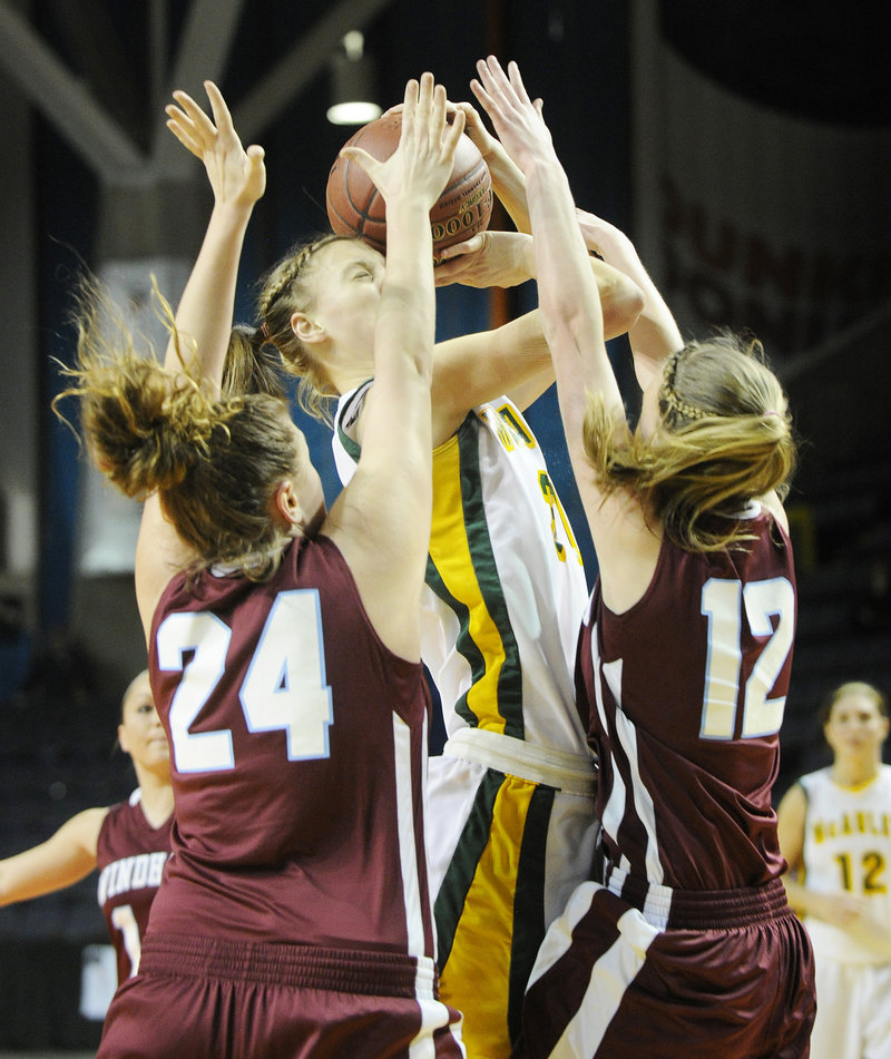 Olivia Smith of McAuley attempts to get the ball to the basket while defended by Diandra Berthiaume, left, and Sam Frost of Windham.