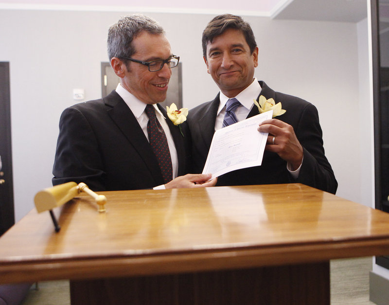 When New York's same-sex law went into effect in July 2011, hundreds of couples legally tied the knot, including Daniel Hernandez, right, and Nevin Cohen, shown holding their wedding certificate in New York City. Increasingly, courts and legislatures are saying same-sex couples shouldn't be treated differently than opposite-sex couples.
