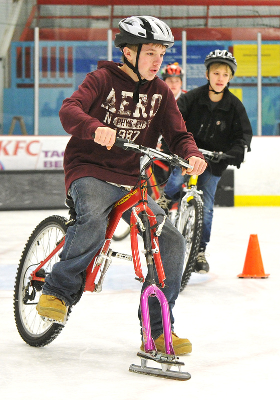 Will Rees and other ice bikers take the final turn in a race at the Biddeford Ice Arena on Saturday. The Bikes on Ice event gave kids involved with the Community Bicycle Center a different way to have fun while cycling.