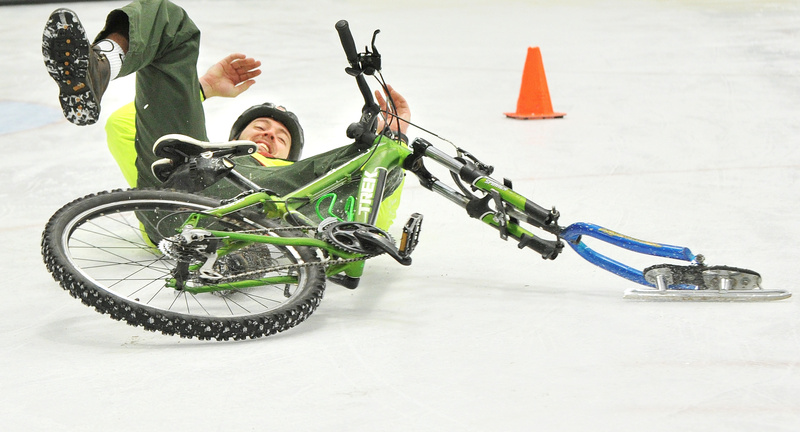 Andrew Burnell, program director at the Community Bicycle Center in Biddeford, takes a spill in the final turn of an ice race in the adult division on Saturday. Last year the center worked with 300 youths who built bicycles or went on bike trips.