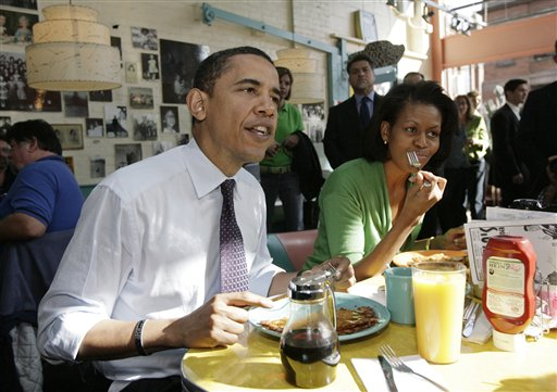 Then-Democratic presidential hopeful, Sen. Barack Obama, and his wife, Michelle, have breakfast at a diner in Pittsburgh during the 2008 presidential campaign. Nobody's talking about what will be on the menu at Friday's Portland fundraiser for the Obama re-election campaign (though we do know what wines will be served – see