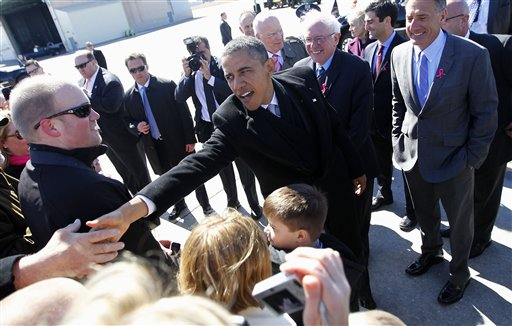 President Barack Obama, accompanied by Sen. Bernard Sanders, I-Vt., and Vermont Gov. Peter Shumlin, greets supporters on the tarmac upon his arrival at Burlington Air National Guard Base today.