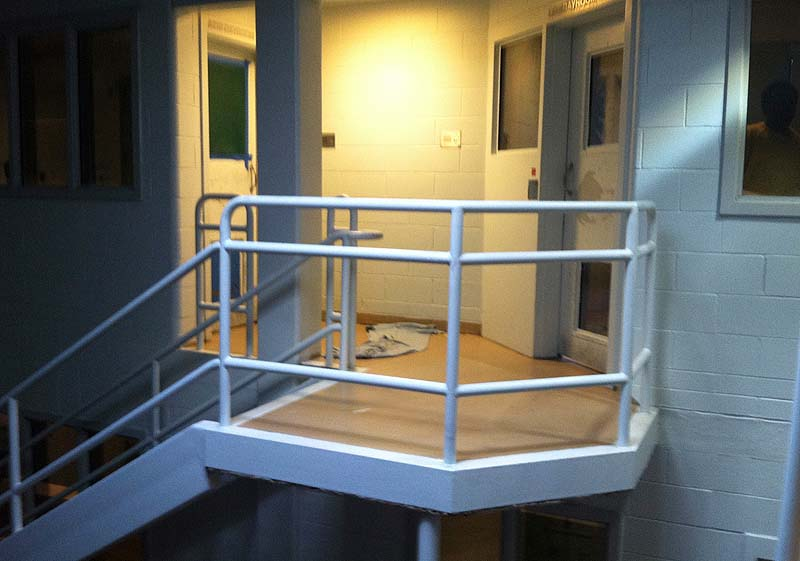 Arien L'Italien crawled across the landing between the maximum-security cellblock, at right, and a women's cellblock, left, where he is accused of having sex with Karla Wilson.