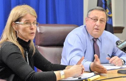 On Tuesday, DHHS Commissioner Mary Mayhew, seen last year with Gov. LePage, announced that a computer glitch resulted in 19,000 ineligible people remaining on the MaineCare rolls.