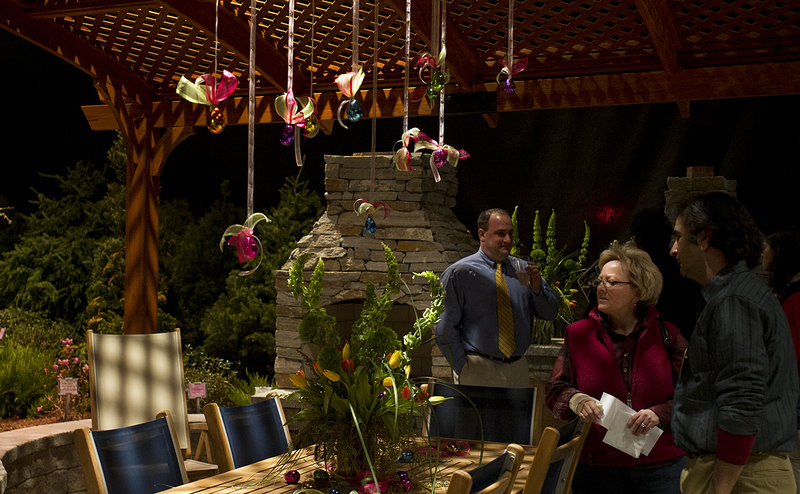 Portland Flower Show visitors look at the Best in Show display from Jaiden Landscaping of Durham during the opening night gala Wednesday. The show, at the Portland Company complex on Fore Street, runs though Sunday.
