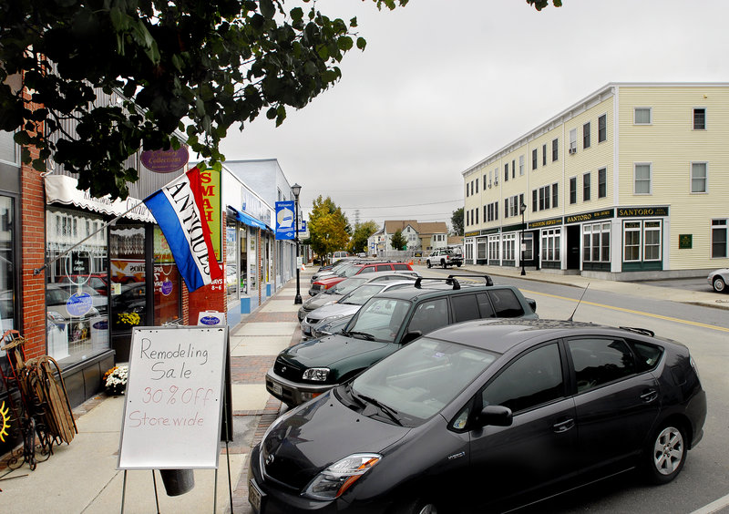 Business owners on Ocean Street in South Portland say their customers prefer the current diagonal parking spaces.