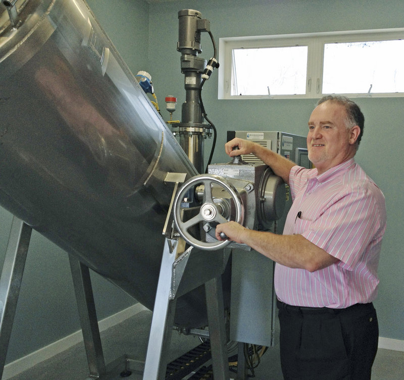 Mark Riposta, owner of Direct Cremation of Maine, stands with his new alkaline hydrolysis system. His business is one of the few commercial crematories in the U.S. using the system.