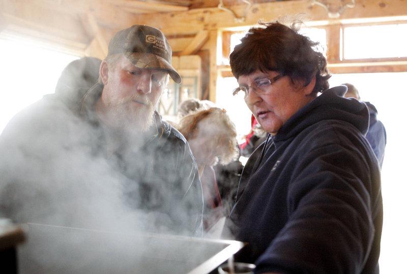 Jo Hartwell explains the sugaring process to Scott Sorenson of Gorham at Jo's Sugarhouse in Gorham on Maine Maple Sunday.