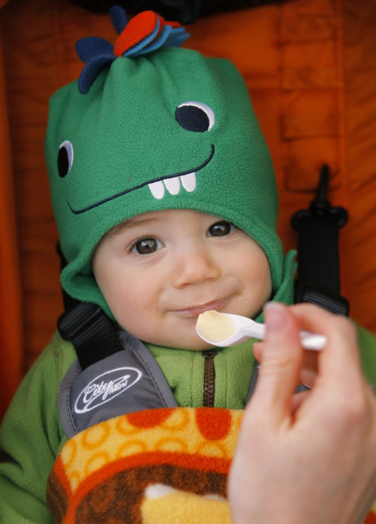 Eight-month-old Beck Michaud seems to enjoy the maple ice cream being fed to him by his mom, Jesi, at Nash Valley Farm in Windham.