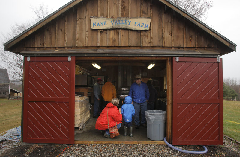 Heidi Donnelly of Scarborough and her son Gehrig, 4, visit the sugarhouse at Nash Valley Farm in Windham on Maine Maple Sunday. Although the farm produced close to 100 gallons of syrup in 2011, this year it made only 40 gallons.