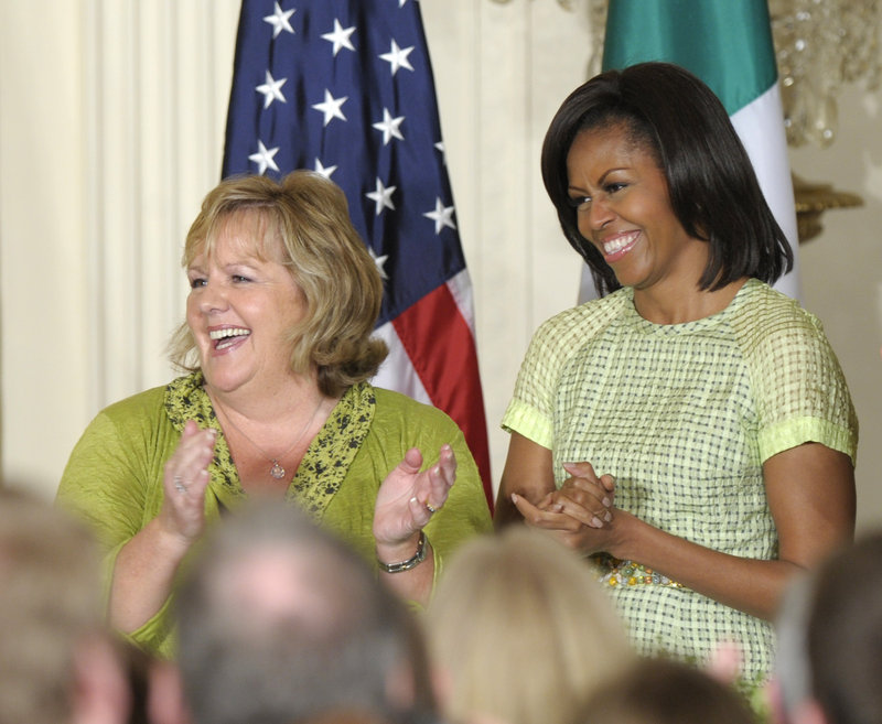 Michelle Obama, right, is known for her kitchen garden at the White House and her healthy eating initiatives. With his love of french fries, hamburgers and banana cream pie, President Obama, below,