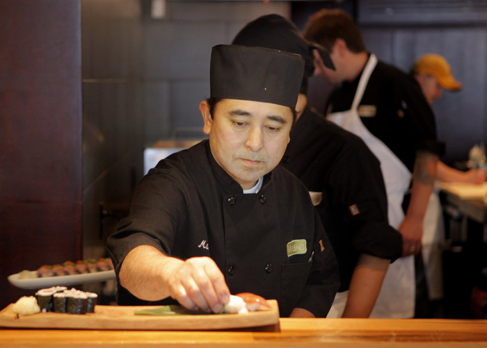 Chef Masa Miyake prepares lunch at his restuarant in Portland in this July 27, 2011, photo.
