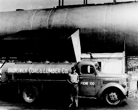 Downeast Energy started as Brunswick Coal in 1908. By the 1940s, when Charlie Descheneaux, above, worked as a truck driver, the company was Brunswick Coal & Lumber.
