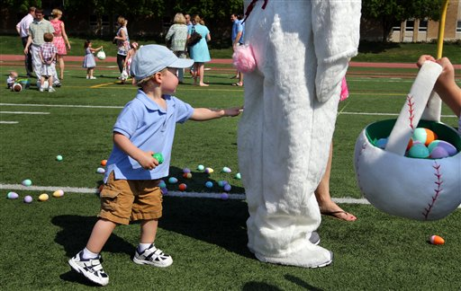 Ben Harvath, 1, of Brentwood, Mo., lets his curiosity get the best of him as he touches the Easter Bunny at an egg hunt Sunday in Creve Coeur, Mo. Ben Harvath;creve coeur mo;desmet jesuit high;Easter;post dispatch;robert cohen;spartans