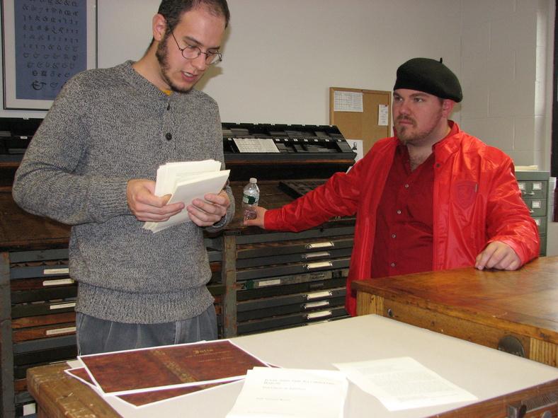 """UMM students Dan Barr, left, and Joshua Luman discuss the """"Julia"""" project."""