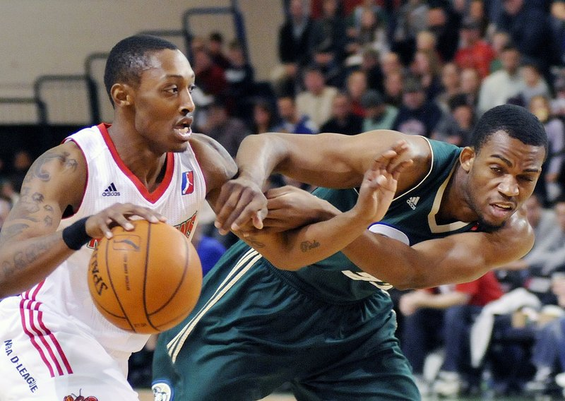 """Point guard Kenny Hayes raised his points-per game average from seven in 2010-11 to 17.1 this year. """"We were better players at the end of the year than we were at the beginning,"""" he said."""