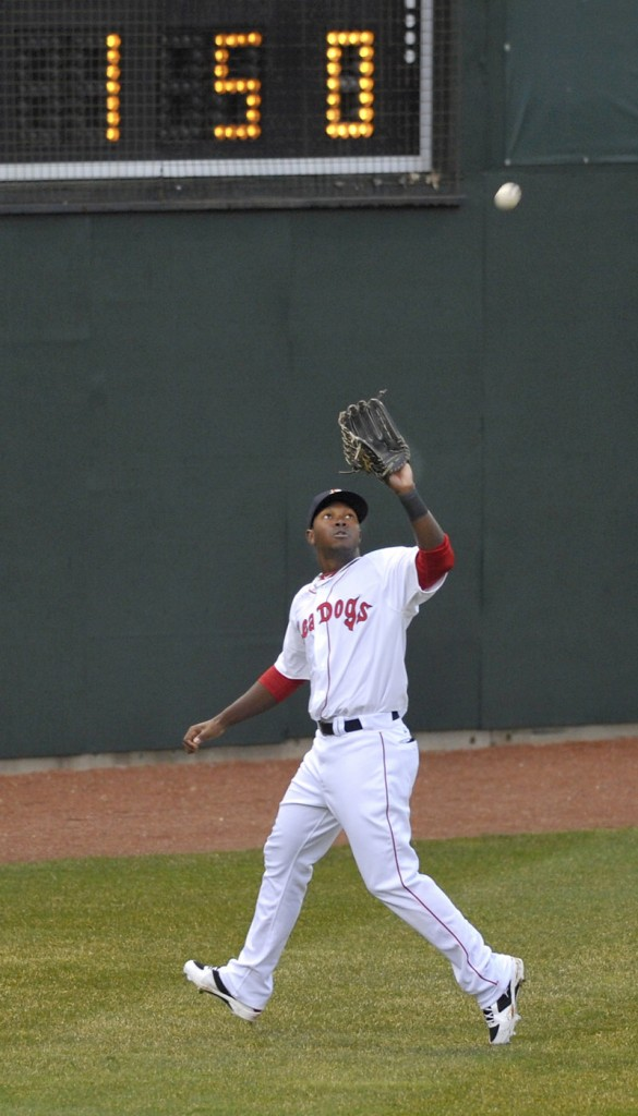 Center fielder Juan Carlos Linares approaches the warning track to haul in a fly ball. Linares homered to lead off the first inning – the only run for the Sea Dogs.