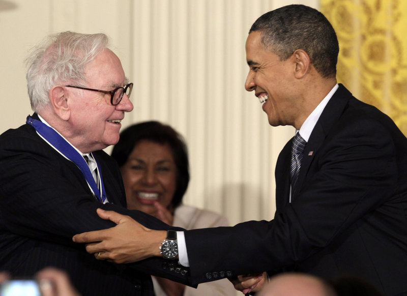 """President Obama greets Warren Buffett, after whom the so-called """"Buffett rule"""" is named."""