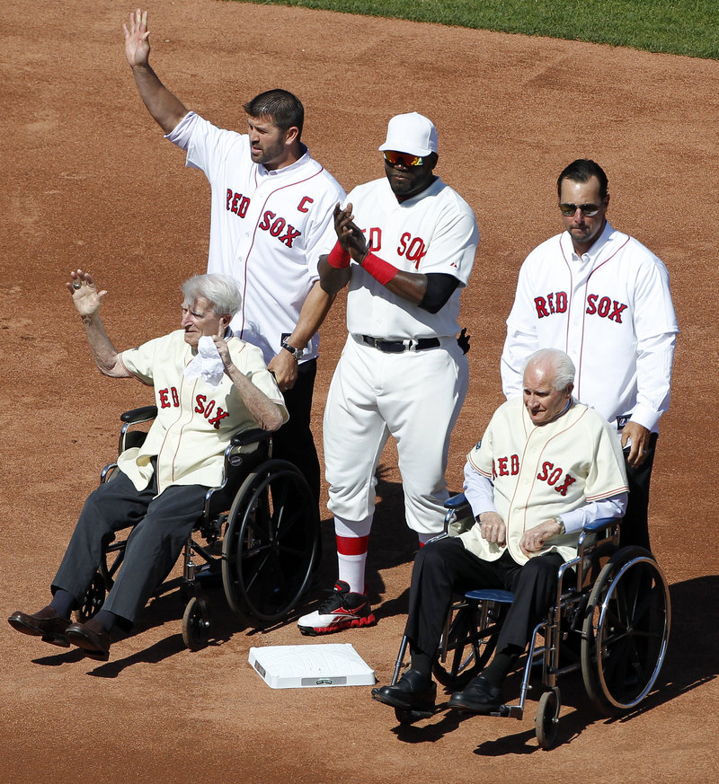 Johnny Pesky, left, and Bobby Doerr were wheeled to second base by the recently retired Jason Varitek and Tim Wakefield, and escorted by David Ortiz during the Fenway Park celebration.