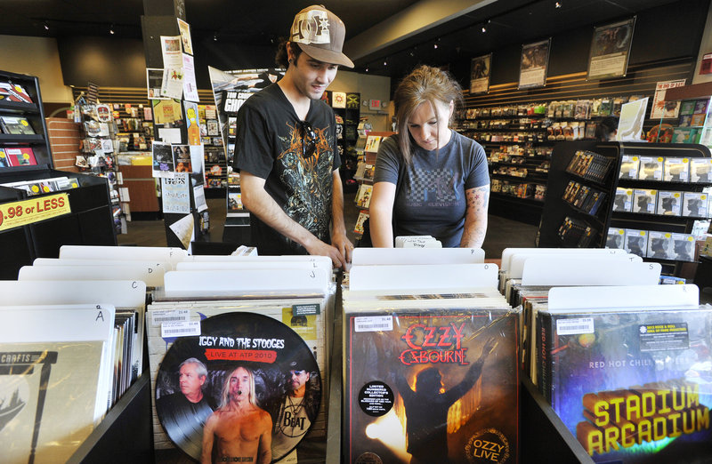 Preston and Heather Bellows of Westbrook comb through vinyl records at Bull Moose Music in Scarborough during Record Store Day events Saturday. Record Store Day, the brainchild of Bull Moose's Chris Brown, is meant to promote independent stores that still offer physical retail locations.