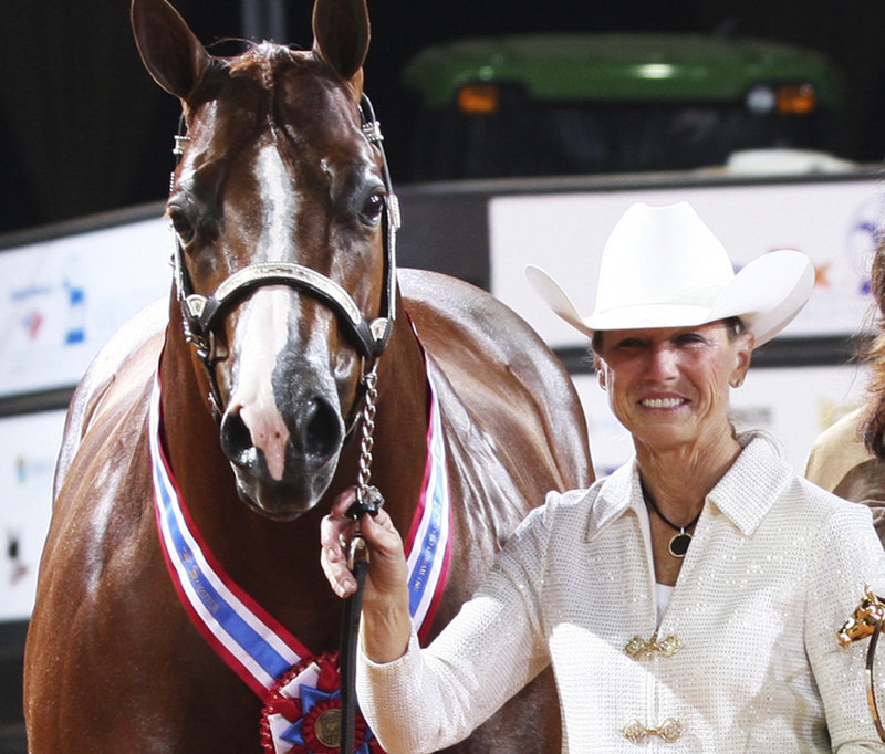 Rita Crundwell of Dixon, Ill., poses with one of her horses at the 2011 American Quarter Horse Association World Championship Show in Oklahoma City. Crundwell, arrested April 17, is accused of siphoning off $30 million from the city of Dixon to support her ranches.