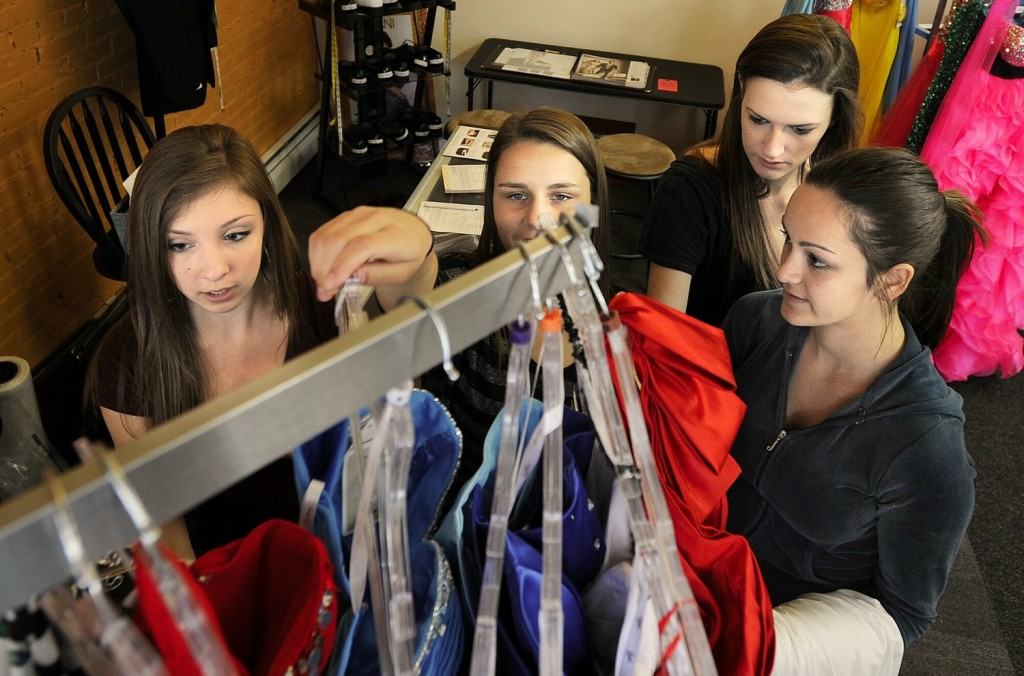 Breanna Battista, Shelby Peterson, Abby Chadburn and Brianna Silva are all headed to the Scarborough High prom. They each tried on several styles of dresses at Simply You Boutique. Gabe Souza/Staff Photographer