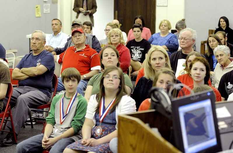 Members of the public listen to a speaker Monday as the Sanford School Committee holds a hearing on changing the name Redskins for Sanford High School teams.