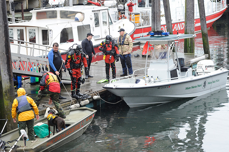 Members of the State and Portland police dive teams search the waters near the State Pier for Nathan Bihlmaier on Monday, May 21, 2012, who went missing after a night with friends in the Old Port.