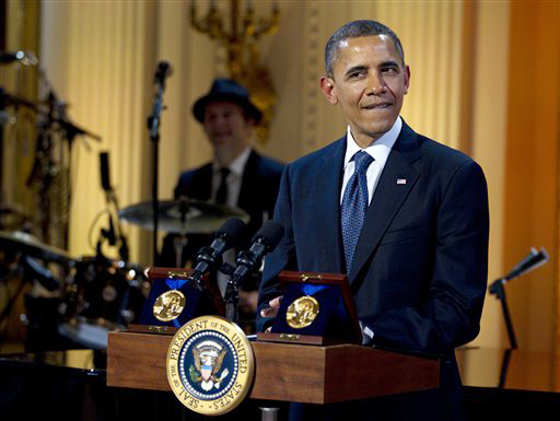 President Barack Obama pauses as he speaks during the