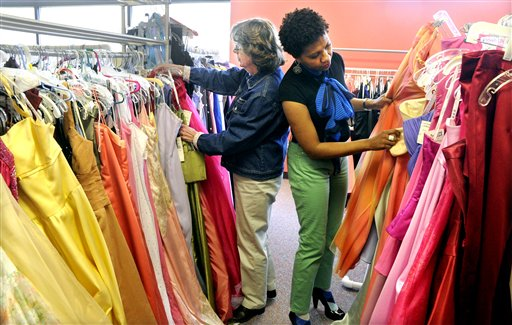 Sue Ficzko, left, and Tracie Springer, co-chairs of YWCA of Bethlehem's (Pa.) annual Prom Dress Day, organize dresses. Hundreds of gowns are arranged by size and color and will be distributed to girls who couldn't otherwise afford to go to prom. (AP Photo/Lisa Massey, Express-Times)