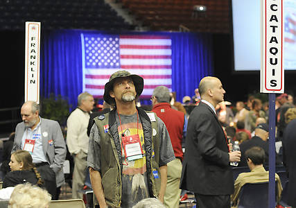 Delegate Frederick Divittorio from Blanchard, Maine, checks out the crowd at the GOP State Convention at the Augusta Civic Center on Saturday, May 5, 2012.