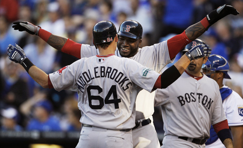 A big hug from Big Papi. That's what was waiting for Will Middlebrooks after his three-run homer in the first Monday in Kansas City. Middlebrooks later added a two-run shot.