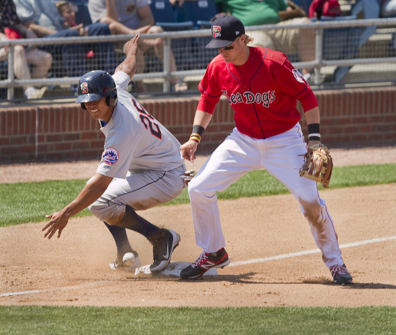 Kolbrin Vitek can't hold on to the ball as Binghamton's Pedro Zapata takes third base on a throwing error after stealing second. Zapata had two stolen bases and scored three runs in Binghamton's 11-7 victory.