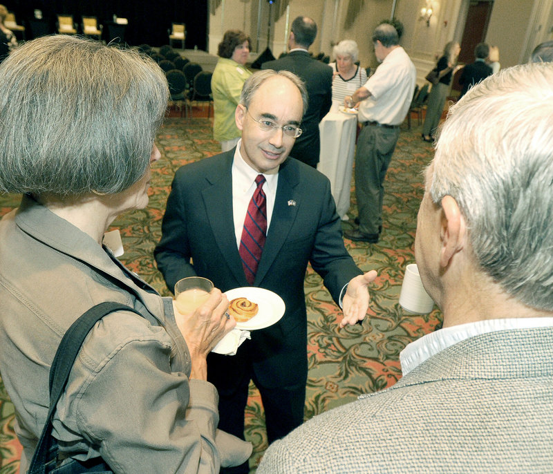 Bruce Poliquin, state treasurer and GOP candidate for U.S. Senate, greets members of the Portland Regional Chamber before an event at Sable Oaks Marriott in South Portland on Wednesday.