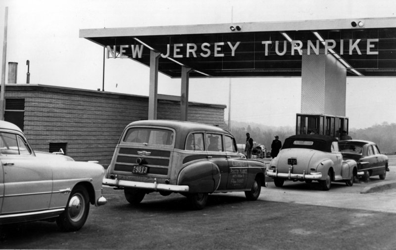 Cars pass through a toll gate of the New Jersey Turnpike as the first 53-mile section between Deepwater and Bordertown, N.J., opens on Nov. 5, 1951. Since then, tolls have been allowed on interstates in 15 states, and other states are fighting limits on tolling.