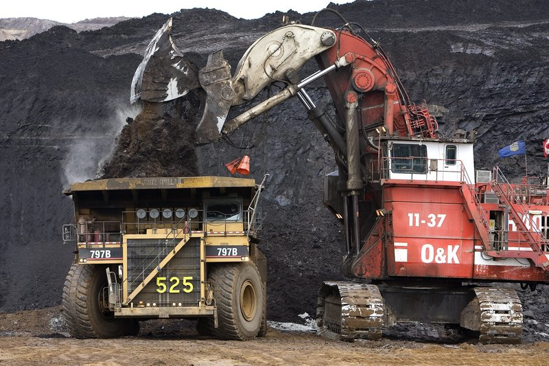 A massive crane loads a high-capacity dump truck at one of Syncrude Canada's Oil Sands mining operations near Fort McMurray, Alberta. Operations like Syncrude's are transforming the Western Hemisphere's role in oil production.