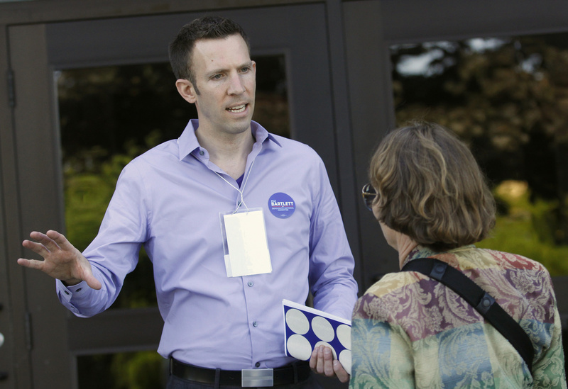 State Sen. Phil Bartlett of Gorham, who is running for Democratic National Committee, talks with Susan Schnur of Islesboro before the convention on Friday.