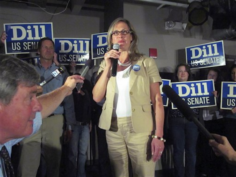 In this June 12, 2012 photo, Maine Sen. Cynthia Dill claims victory in the race for the Democratic nomination to run for the U.S. Senate, at a Democratic