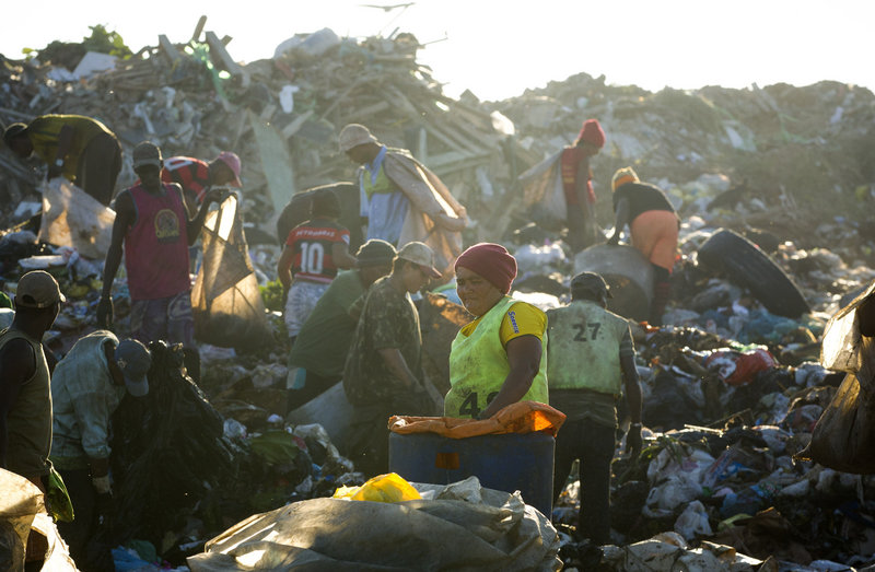 """Trash pickers, or """"catadores,"""" collect recyclable materials May 29 at Jardim Gramacho in Rio de Janeiro, Brazil. They will receive a lump-sum payout from the city, but there's no place for them at the new high-tech dump."""