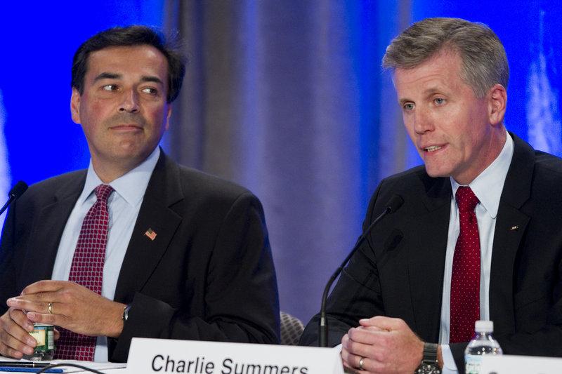 U.S. Senate hopeful Rick Bennett, left, listens to rival Charlie Summers during the Republican debate Saturday.