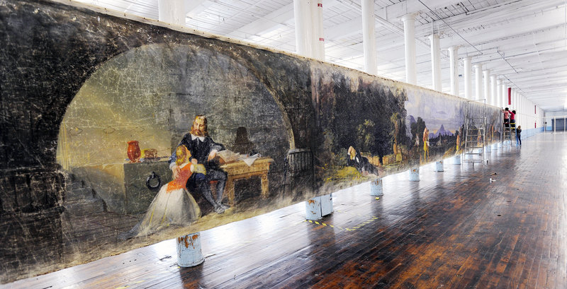 """A section of the 800-foot muslin scroll """"Moving Panorama of Pilgrim's Progress"""" goes up in the cavernous former loom room at the Pepperell Mill complex in Biddeford."""