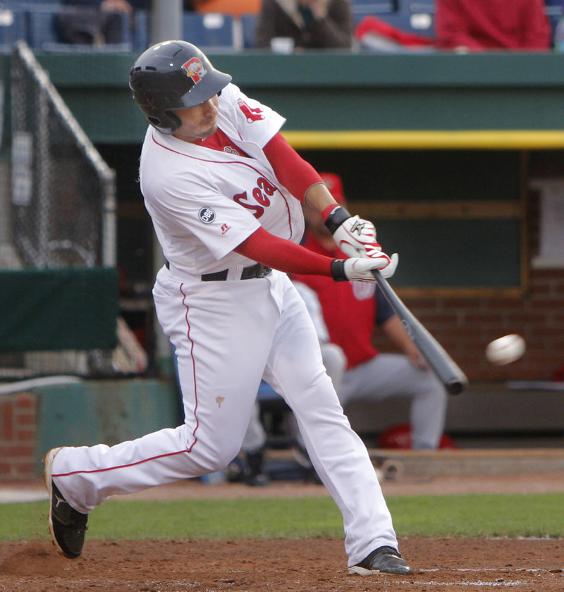 Ryan Dent, who collected three hits Tuesday night for the Sea Dogs, strokes a single during a nine-run fourth inning that carried Portland to a 14-0 victory against the Harrisburg Senators at Hadlock Field.